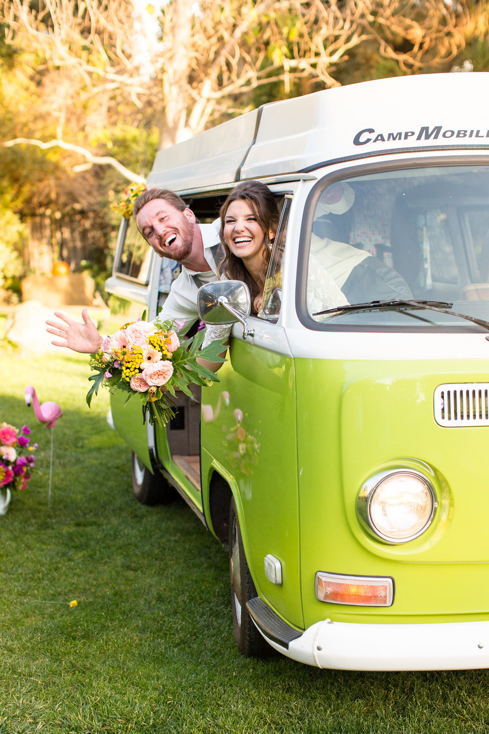 bride and groom both inside green vw bus happily smiling kim baker beauty san jose california makeup artist wedding styled photoshoot at the holly farm in carmel