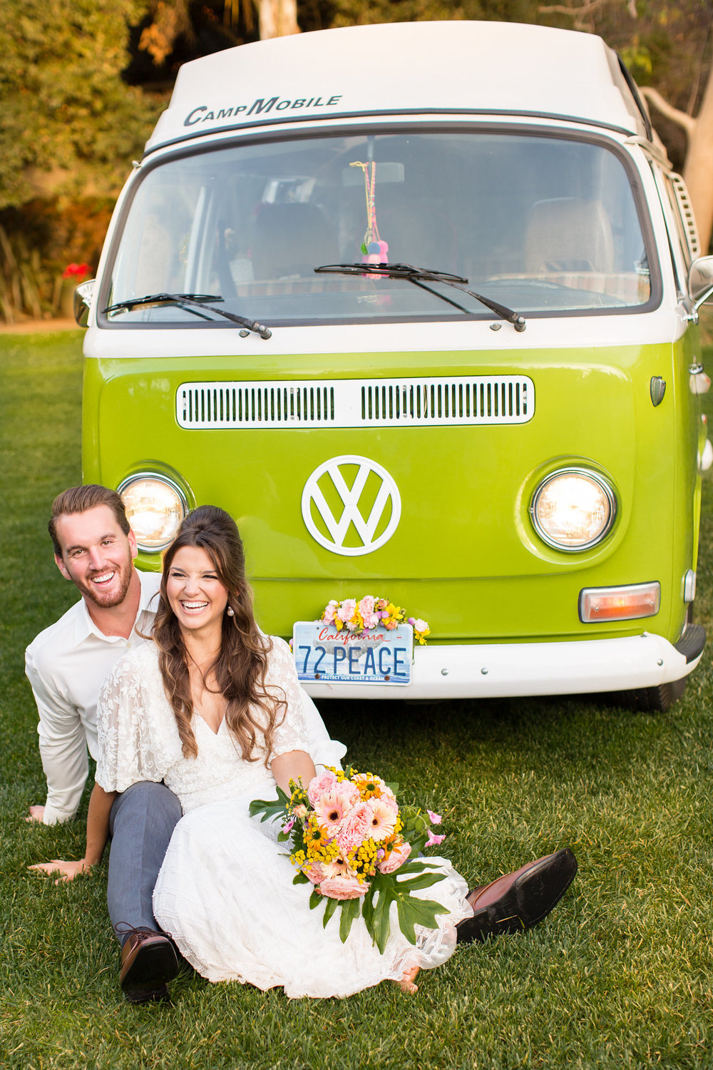 bride and groom sitting in front of green vw bus with large tropical bouquet kim baker beauty san jose california makeup artist wedding styled photoshoot at the holly farm in carmel