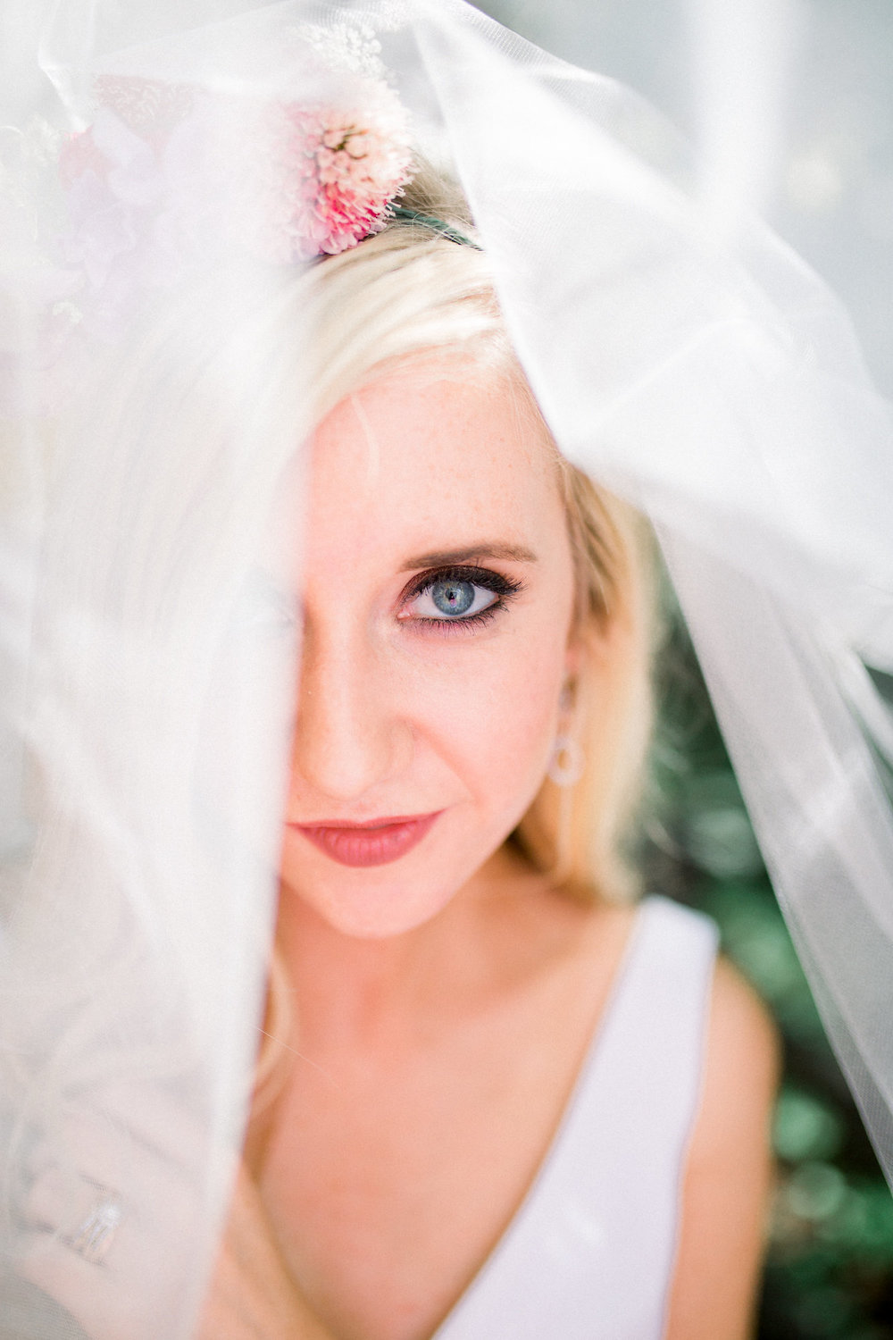 bride with clean makeup, dark nude lip, and brown shimmer eyeshadow with sonia rosellie drop false lashes kim baker beauty san jose california makeup artist