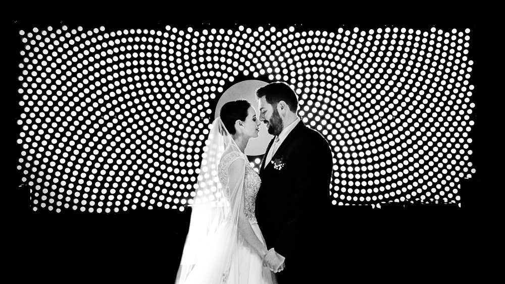bride and groom in front of mural at the tech museum black and white photo with veil on wedding day makeup by kim baker beauty san jose california makeup artist