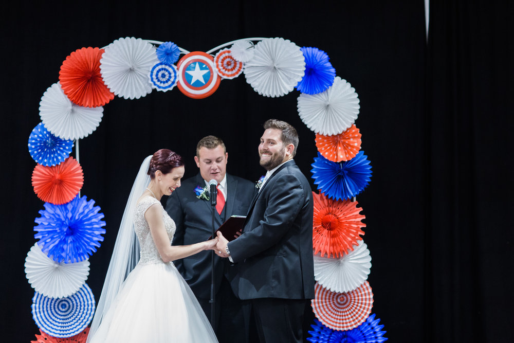 bride and groom at captain america theme wedding at the altar getting married at the tech museum makeup by kim baker beauty san jose california makeup artist