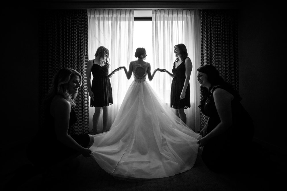 bride with her bridesmaids in the bridal suite makeup by kim baker beauty san jose california makeup artist