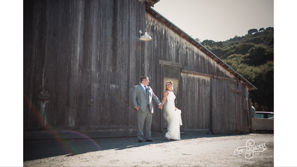 bride and groom at picchetti winery in cupertino taking portraits in front of barn makeup by kim baker beauty san jose california makeup artist