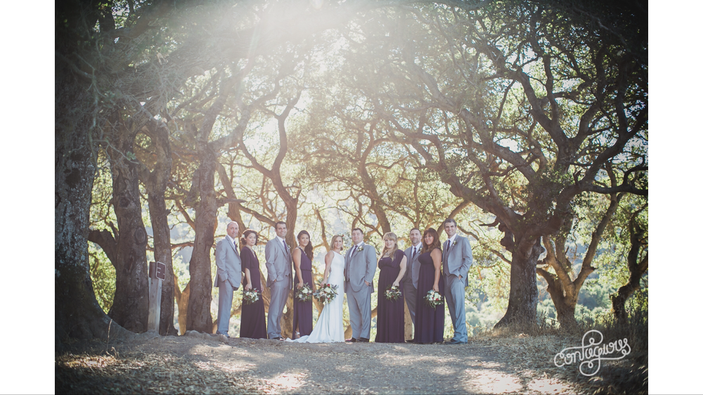 bride and groom at picchetti winery in cupertino taking portraits on hiking train in nature with bridal party makeup by kim baker beauty san jose california makeup artist