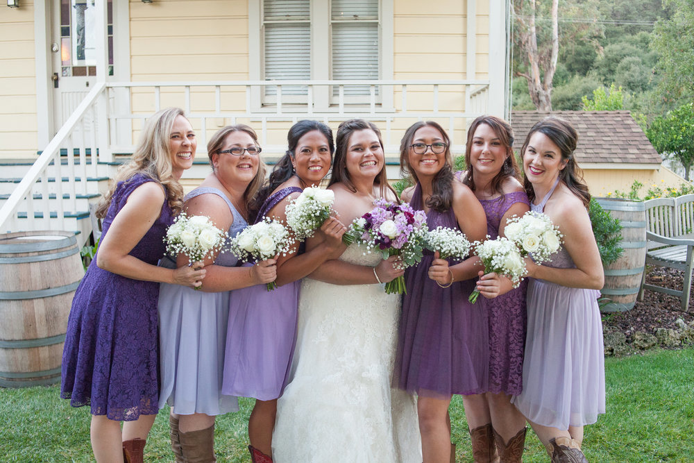 curvy bride in sweetheart strapless lace wedding gown with bridemaids in cowboy boots picchetti winery wedding in cupertino makeup by kim baker beauty san jose california makeup artist