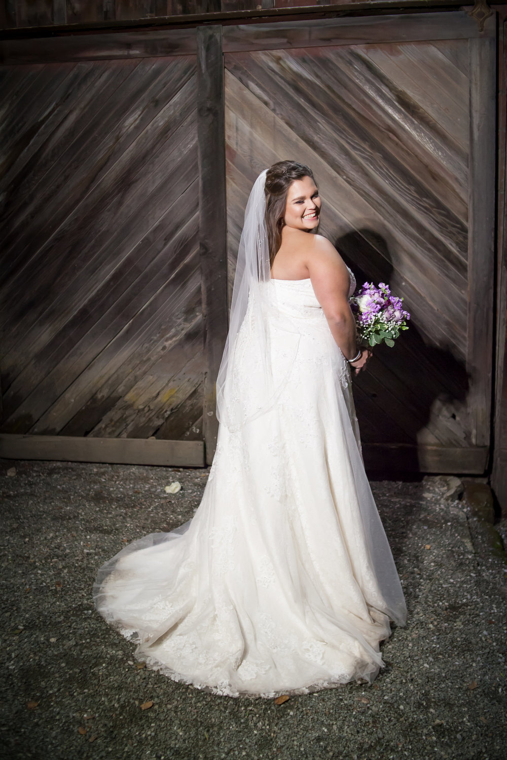 bride wearing veil and strapless floor length wedding gown with small train makeup by kim baker beauty san jose california makeup artist at picchetti winery in cuptertino