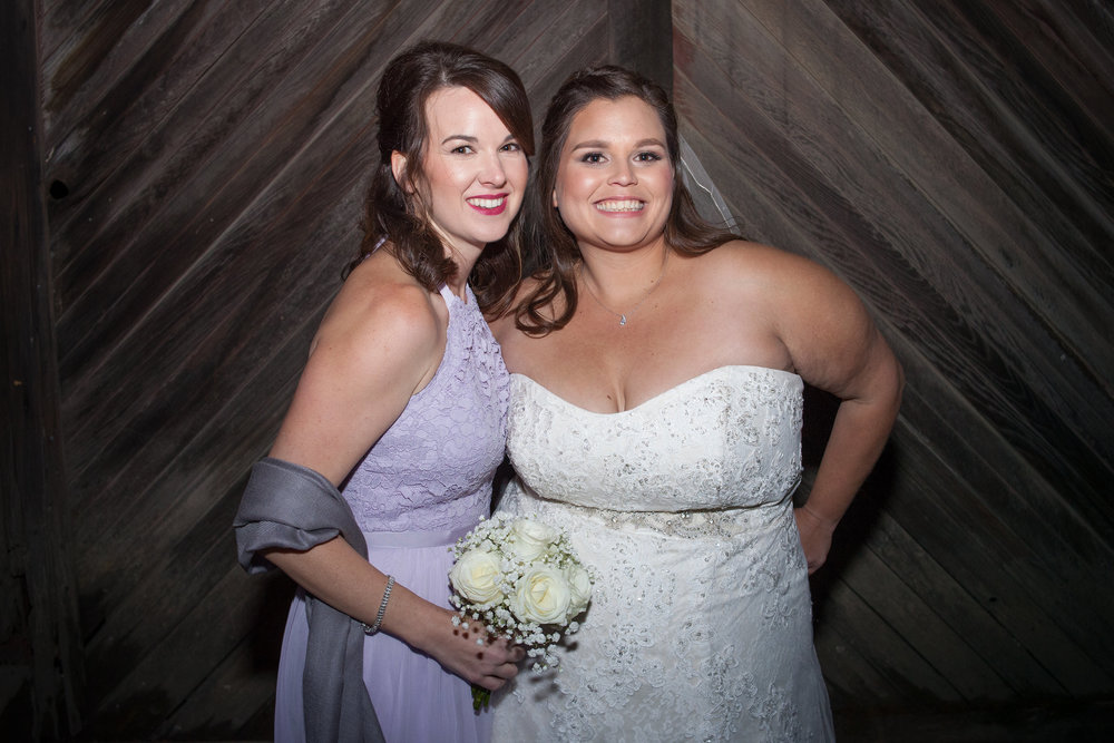 bride in strapless sweetheart bridal gown with bridesmaid in purple dress makeup by kim baker beauty san jose california makeup artist at picchetti winery in cuptertino