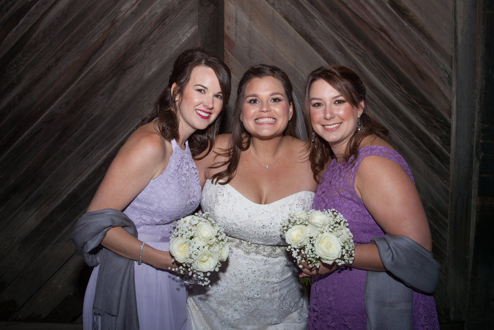 bride in strapless sweetheart bridal gown with two bridesmaids in purple dresses makeup by kim baker beauty san jose california makeup artist at picchetti winery in cuptertino