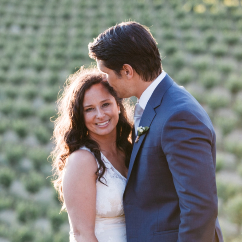 bride and groom at golden hour in vineyards in sutter creak natural bridal makeup by kim baker beauty san jose california