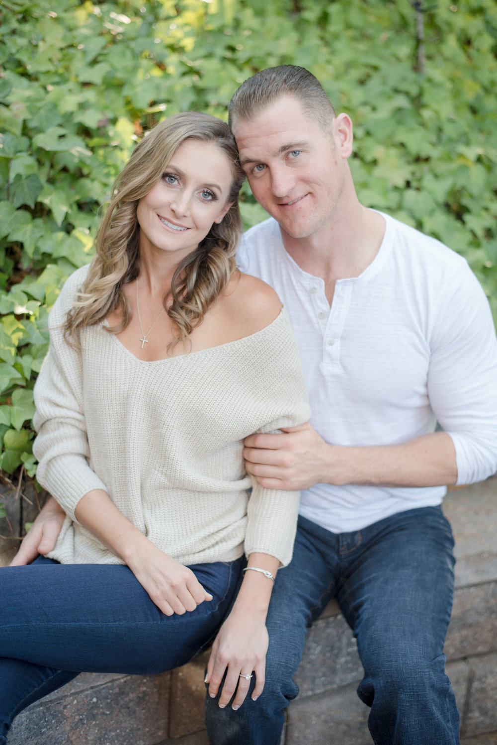 outdoor cozy engagement photoshoot in santa cruz bride wearing off the shoulder sweater jeans and booties soft glam neutral makeup by kim baker beauty san jose california makeup artist