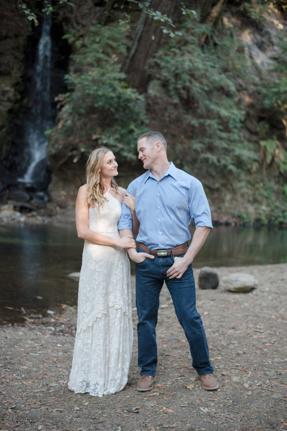 outdoor engagement photoshoot in santa cruz next to creek bride wearing cream lace maxi dress soft glam neutral makeup by kim baker beauty san jose california makeup artist