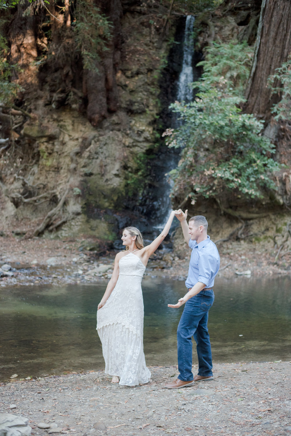 outdoor engagement photoshoot in santa cruz next to creek bride wearing cream lace maxi dress soft glam neutral makeup by kim baker beauty san jose california makeup artist quianna marie photography