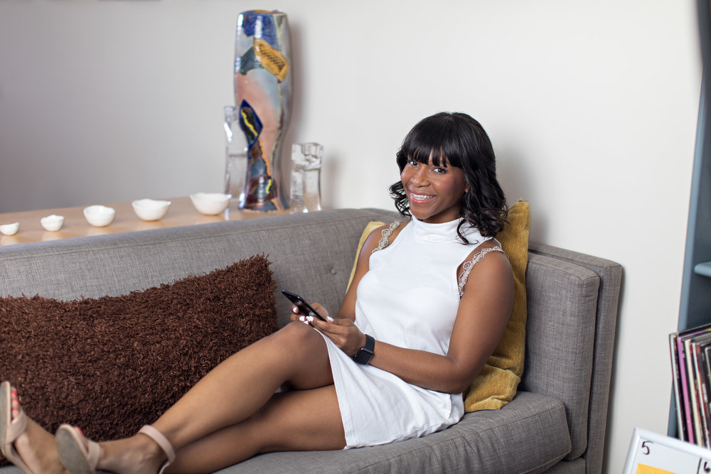 i'm social savvy owner lounging on couch while working in sleeveless white dress wearing fresh bright and glowing makeup by kim baker beauty san jose makeup artist