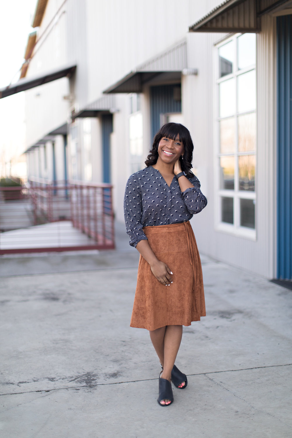 sharon hadden wearing navy patterned button up blouse and cognac knee length skirt with peep toe booties in glowing makeup by kim baker beauty san jose california makeup artist