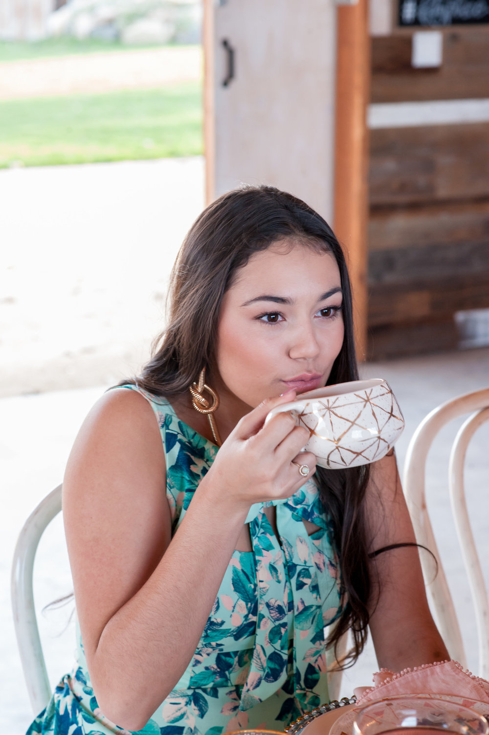 model sipping tea wearing glowing rose toned natural glam makeup by kim baker beauty san jose california makeup artist