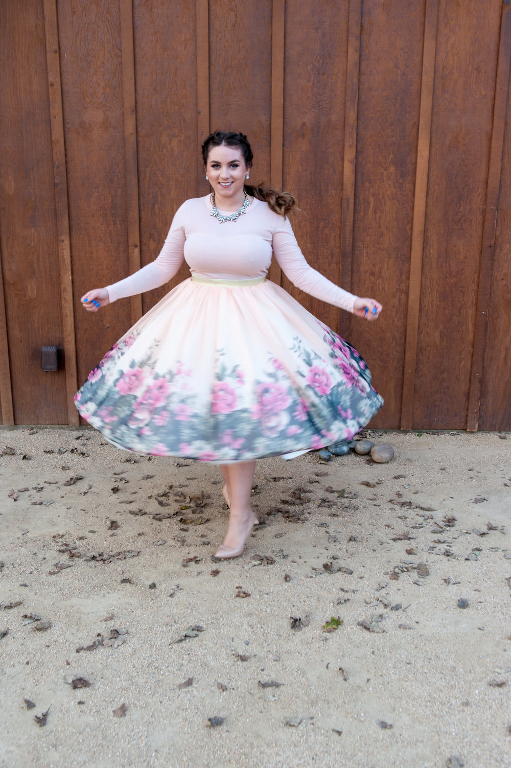 bridesmaid twirling in floral skirt wearing rose toned soft romantic glam glowing makeup by kim baker beauty san jose california makeup artist