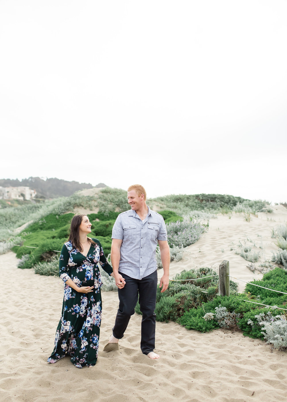maternity photo session at baker beach san fransisco mom is long floral flowy dress soft romantic natural makeup by kim baker beauty san jose california makeup artist