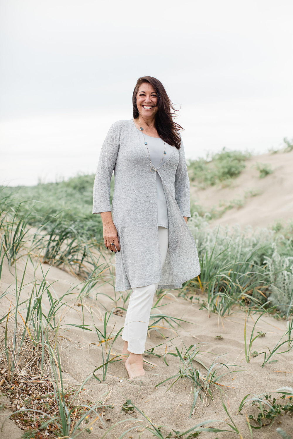 mature model wearing gray beachy sweat set at baker beach san francisco glowing natural makeup by kim baker beauty san jose california makeup artist