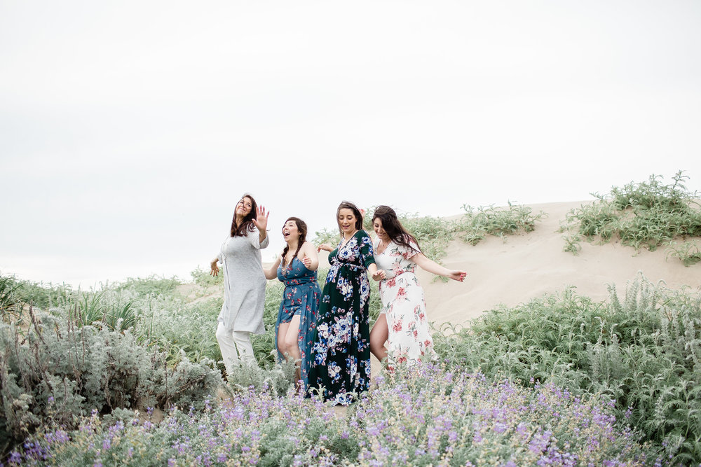 pregnant mom to be with aunts and grandma dancing on baker beach san francisco in floral print dresses rose toned romantic soft glam makeup by kim baker beauty san jose california makeup artist