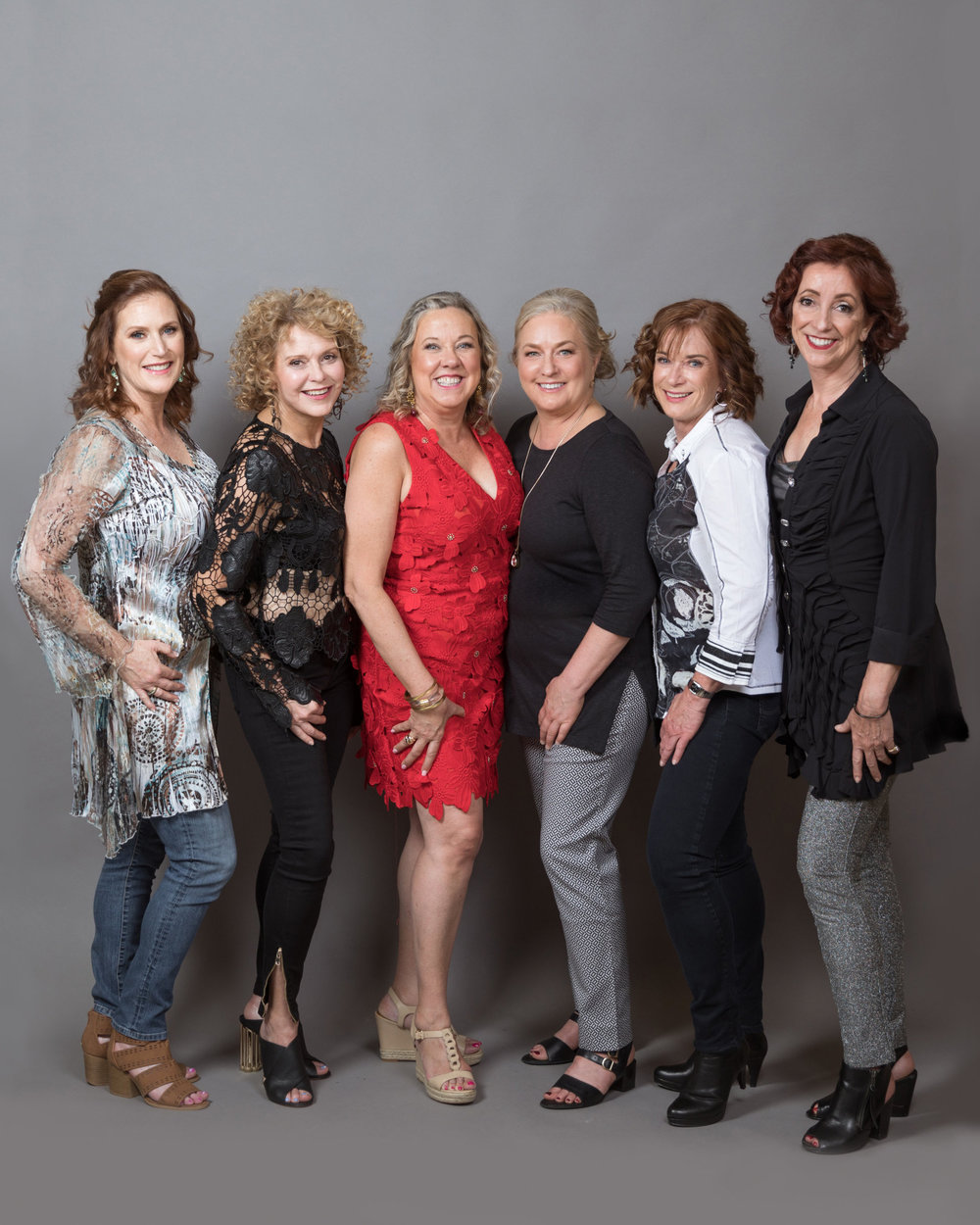 portrait party gray backdrop with 6 women in dressy casual clothing on their way to see Taylor Swift makeup by kim baker beauty san jose caliornia makeup artist