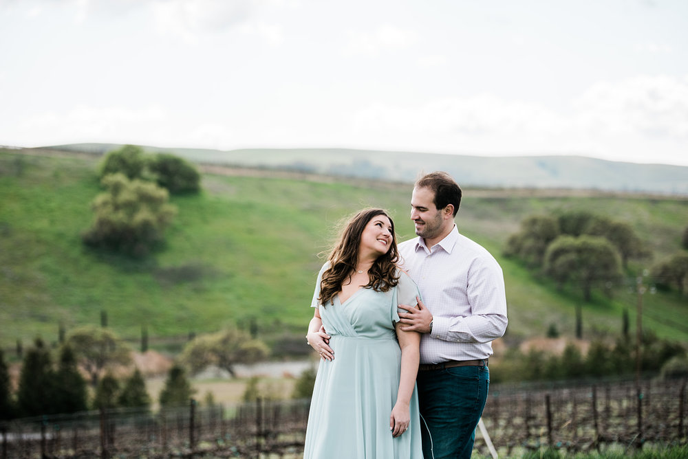 engagement photo session in livermore bride wearing slate blue flowing dress and warm rose glowing romantic makeup by kim baker beauty san jose california makeup artist