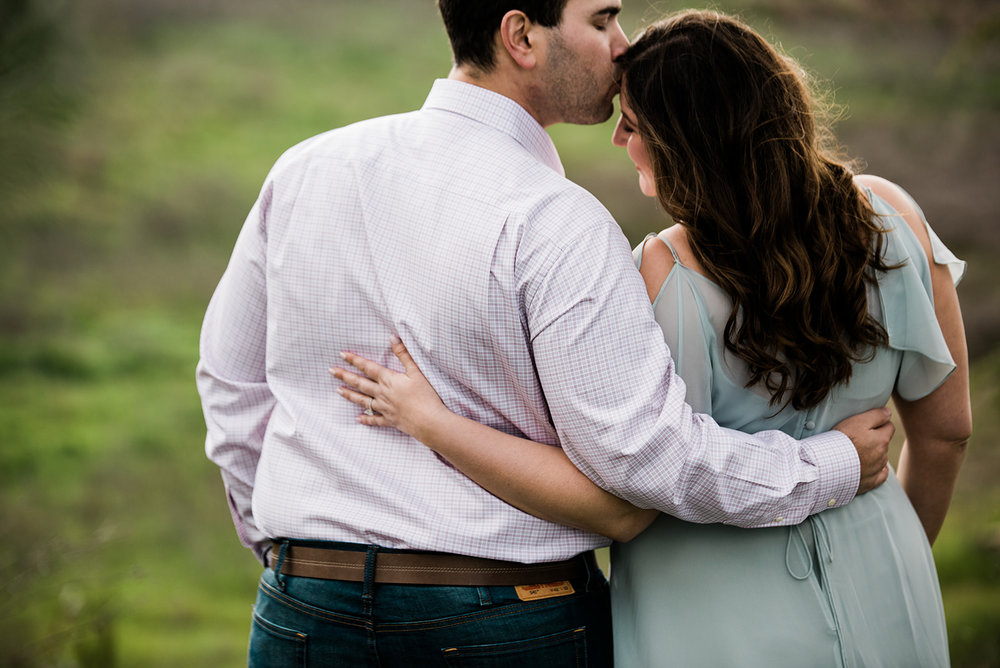 madly in love couple during engagement photo session in livermore vineyards bride wearing glowing dewey romantic makeup by kim baker beauty san jose california makeup artist