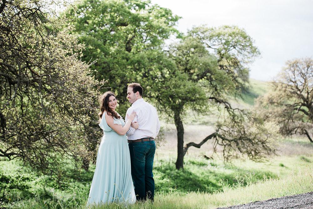 bride wearing floor length soft blue flowy dress and dewey glowing romantic glam makeup by kim baker beauty san jose california makeup artist
