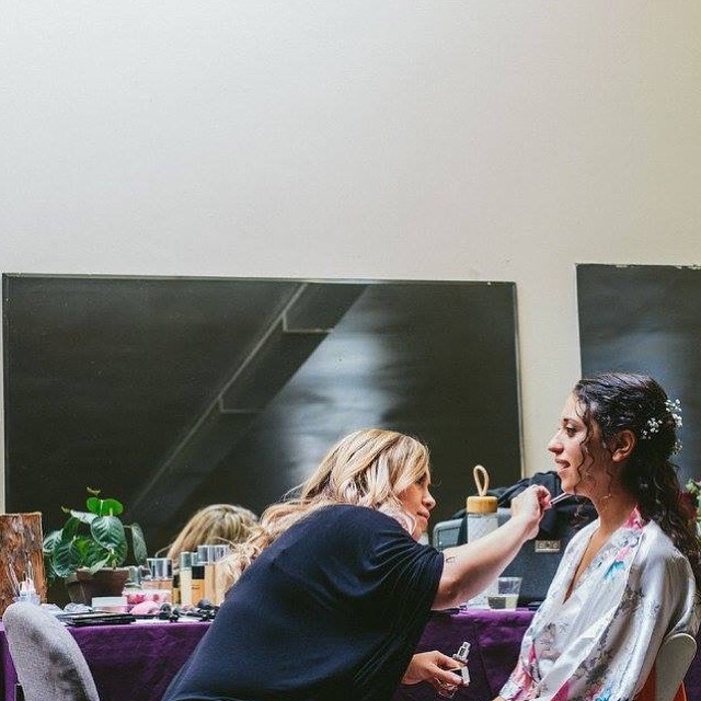 pema osel ling wedding in the redwoods kim baker beauty san jose california makeup artist intimately applying light radient dewey and glowing foundation