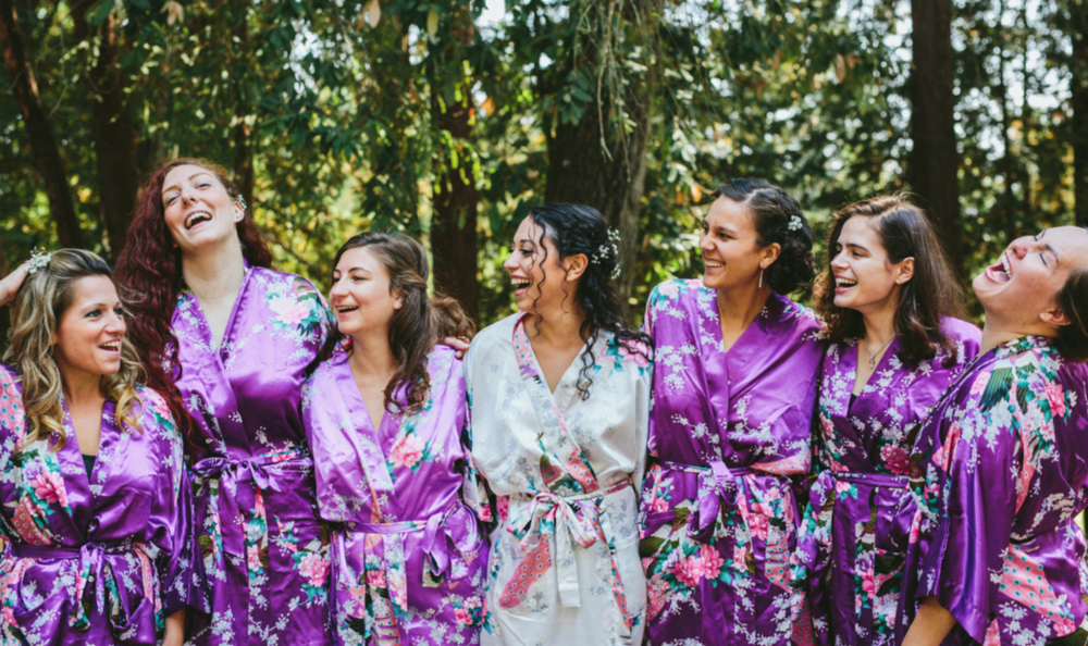 glowingly happy bride with bridesmaids at pema osel ling wedding in the redwoods kim baker beauty san jose california makeup artist applied natural dewey glowing makeup
