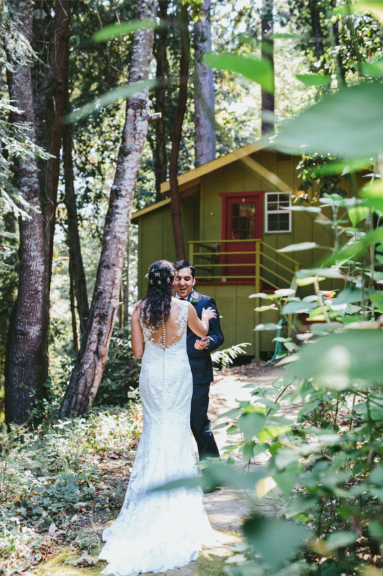 bride and groom's first look at pema osel ling wedding in the redwoods kim baker beauty san jose california makeup artist applied natural glowing makeup