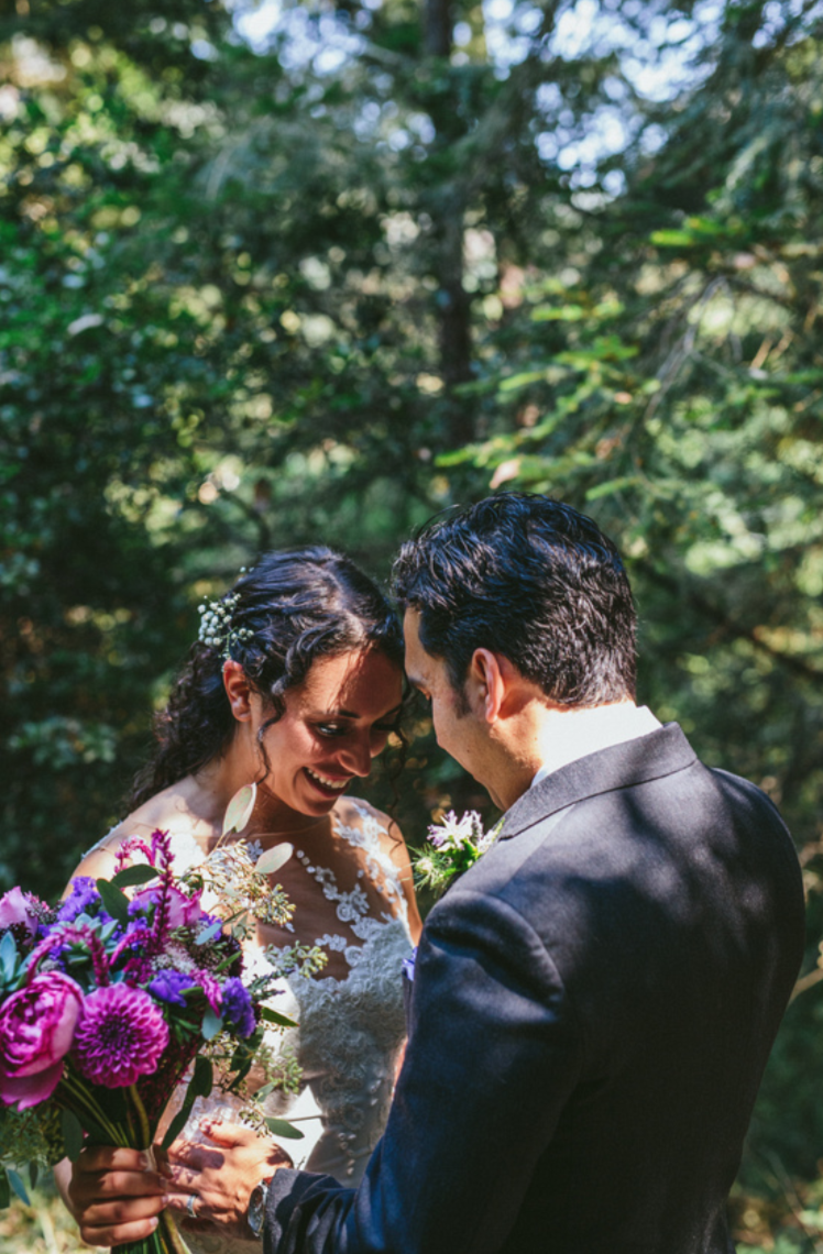 groom checking out his bride at pema osel ling wedding in the redwoods kim baker beauty san jose california makeup artist applied natural dewey romantic makeup