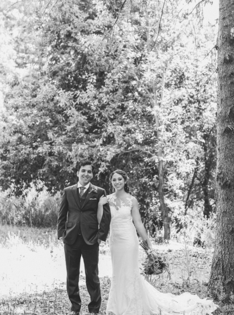 black and white full body portrait of bride and groom at pema osel ling redwood retreat with makeup by kim baker beauty san jose california