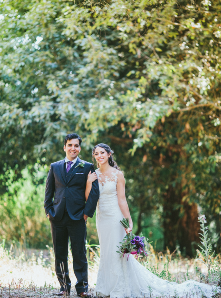 full body portrait of bride and groom at pema osel ling redwood retreat with natural glowing dewey light makeup by kim baker beauty san jose california