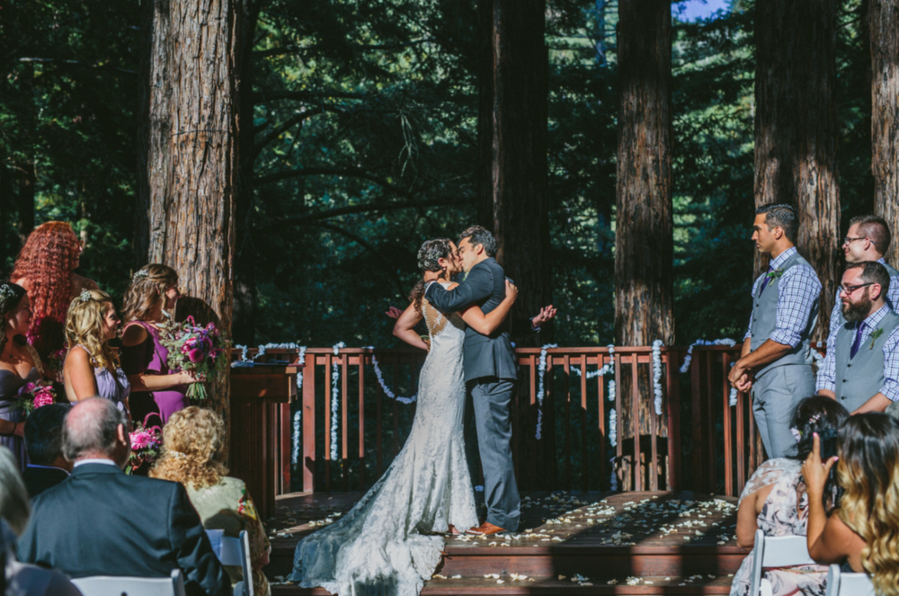 bride and groom kiss to signify marriage at pema osel ling in watsonville