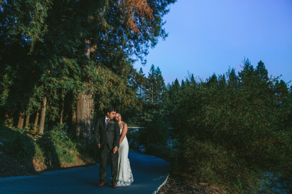 sunset portraits of bride leaning onto groom's shoulder smiling in glowing dewey natural earth toned makeup by kim baker beauty san jose california makeup artist