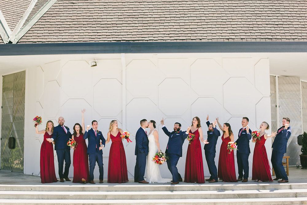 bridal party portraits with bridesmaids wearing maroon gowns and groomsmen in navy suits bridal makeup by kim baker beauty san jose california makeup artist