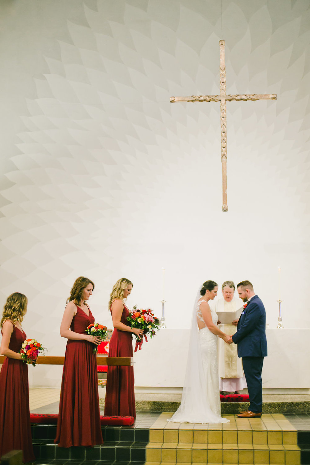 beautiful church wedding ceremony in july with bride in lace dress and wearing soft glowing naturally glamorous makeup by kim baker beauty san jose california makeup artist