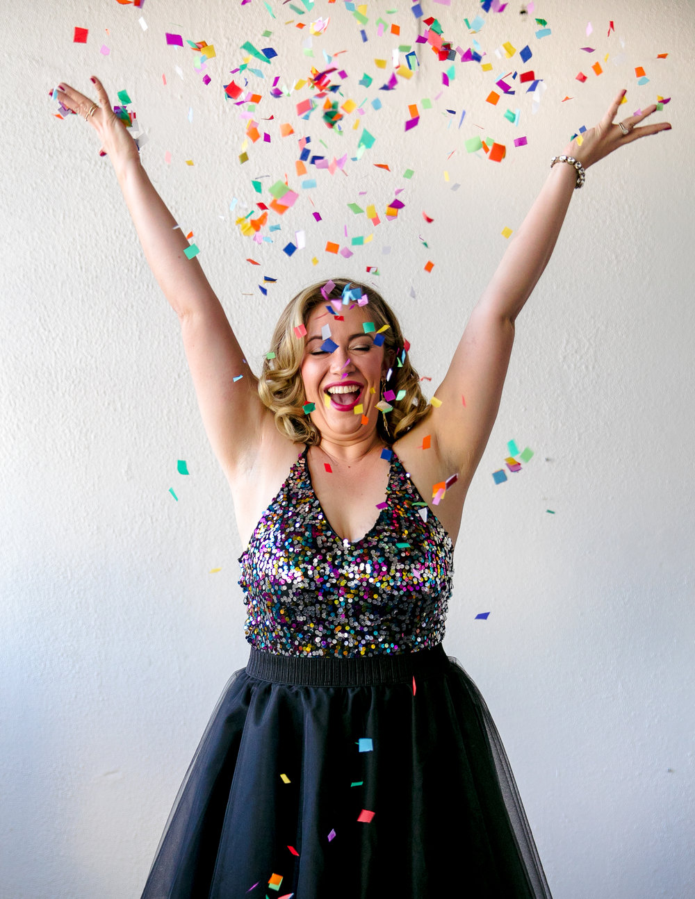 san jose california makeup artist kim baker beauty celebrates 30th birthday with a fun photoshoot wearing tulle skirt and tossing rainbow confetti