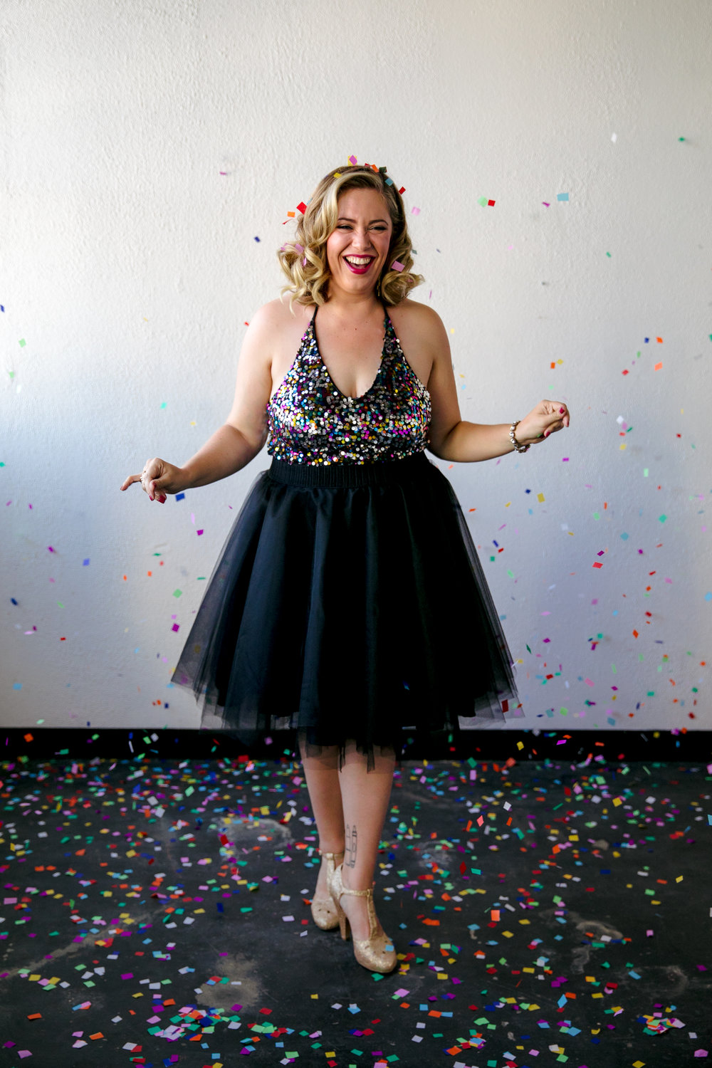 san jose california makeup artist kim baker beauty celebrates 30th birthday with a fun photoshoot wearing tulle skirt and standing on rainbow confetti