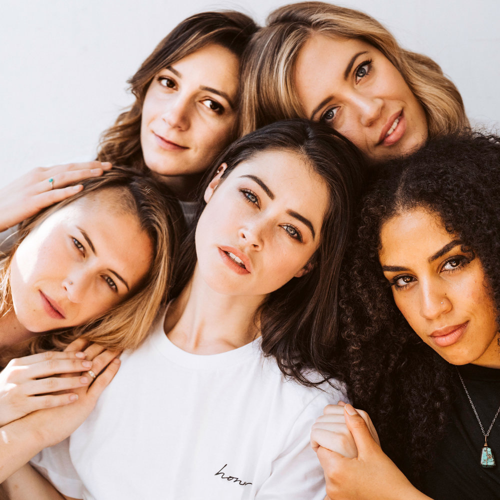 hair and makeup for egoless good by san jose lifestyle and bridal makeup artist kim baker beauty five models holding one another in sisterhood