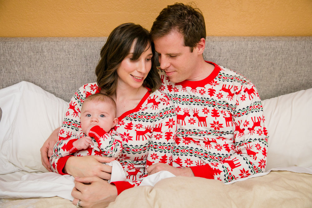 family in christmas pajamas for in home newborn lifestyle session by photographer hi + hello photo hair and makeup on mom by san jose california bridal and lifestyle makeup artist kim baker beauty