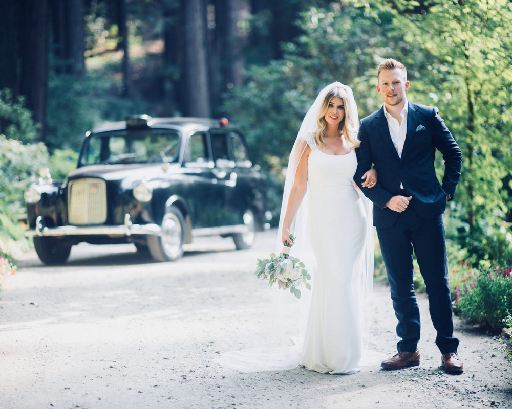 bride and groom at nestledown in los gatos wedding venue with old car