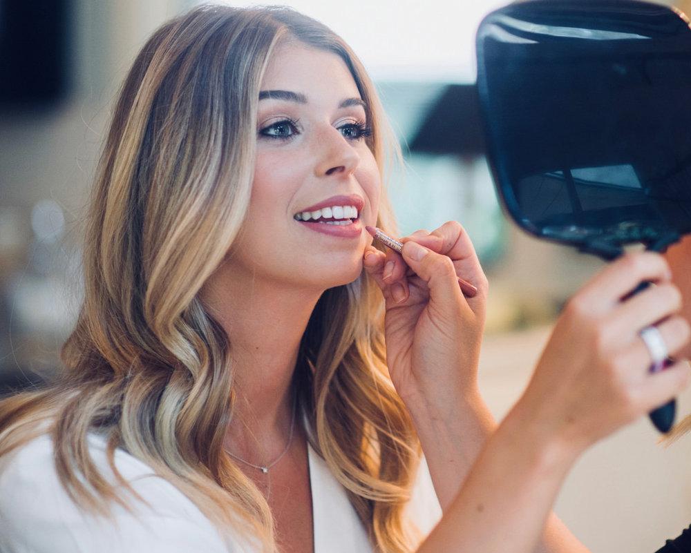 san jose california makeup artist applying makeup to bride at nestledown wedding venue in los gatos california