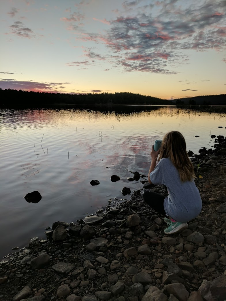 My oldest, capturing an unbelievable sunset using the polaroid she was given, for that purpose.