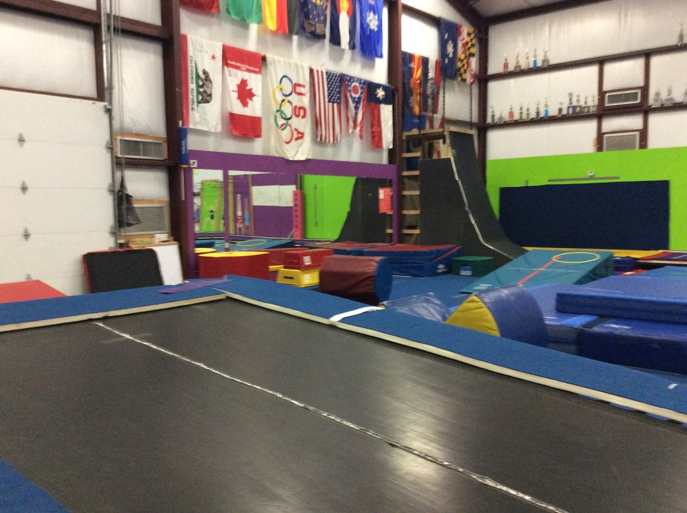 incline trampoline, warp wall, and rope climb