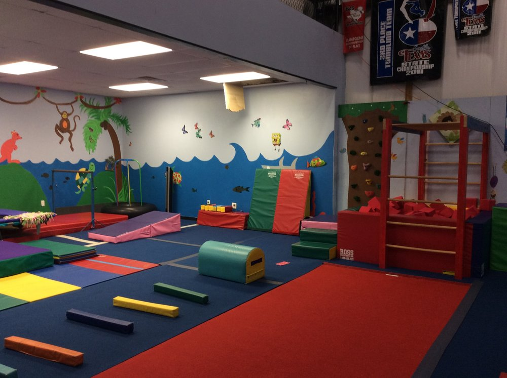 Preschool room includes a trampoline, foam pit, and many other fun mats to entertain your preschooler.