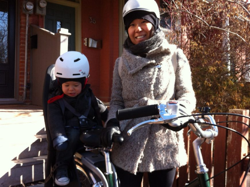 Dr. Sarah Kim, seen with her son, is a year round cyclist in Toronto, who is lucky to be alive after being knocked into traffic when a car door opened in front of her.  (SARAH KIM PHOTO)