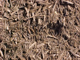 Double shredded mulch - Typically a mix of tree bark and wood that is run through a tub grinder twice.