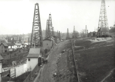 """DERRICKS IN THE CITY OF WASHINGTON, PA   """"Oil and gas discoveries fueled a boom in Washington County, Pennsylvania from the 1880s to the early 1900s. For a time, the McGugin Gas Well was the largest flow of natural gas in the world and provided Pittsburgh with most of its natural gas needs."""".   Source"""