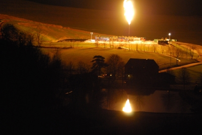 Candlestick flare marking early production from a Marcellus Shale gas well near Hickory, Pa.
